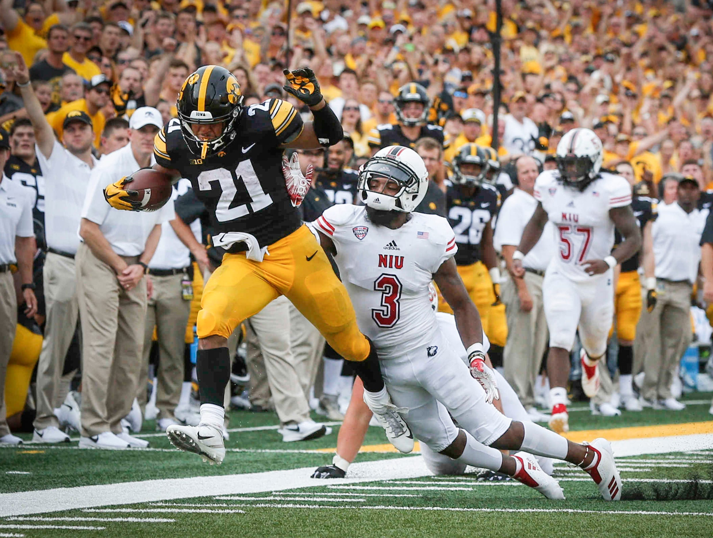 Iowa running back Ivory Kelly-Martin runs the ball for a first down against Northern Illinois University on Saturday, Sept. 1, 2018, at Kinnick Stadium in Iowa City.