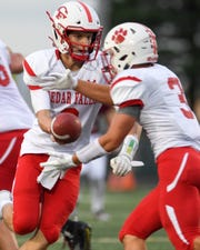 Cedar Falls Quarterback Cael Loecher (8) hands off to Bo Grosse (3) on Friday, Sept. 7, 2018 during a football game between the Ankeny Hawks and the Cedar Falls Tigers at Northview Middle School.
