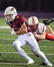 Ankeny's Landon Wolf (7) fights his way up field on Friday, Sept. 7, 2018 during a football game between the Ankeny Hawks and the Cedar Falls Tigers at Northview Middle School.