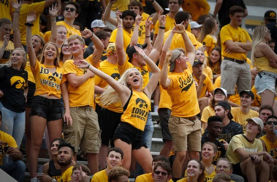 Iowa fans dance during a media time out against Northern Illinois on Saturday, Sept. 1, 2018, at Kinnick Stadium in Iowa City.