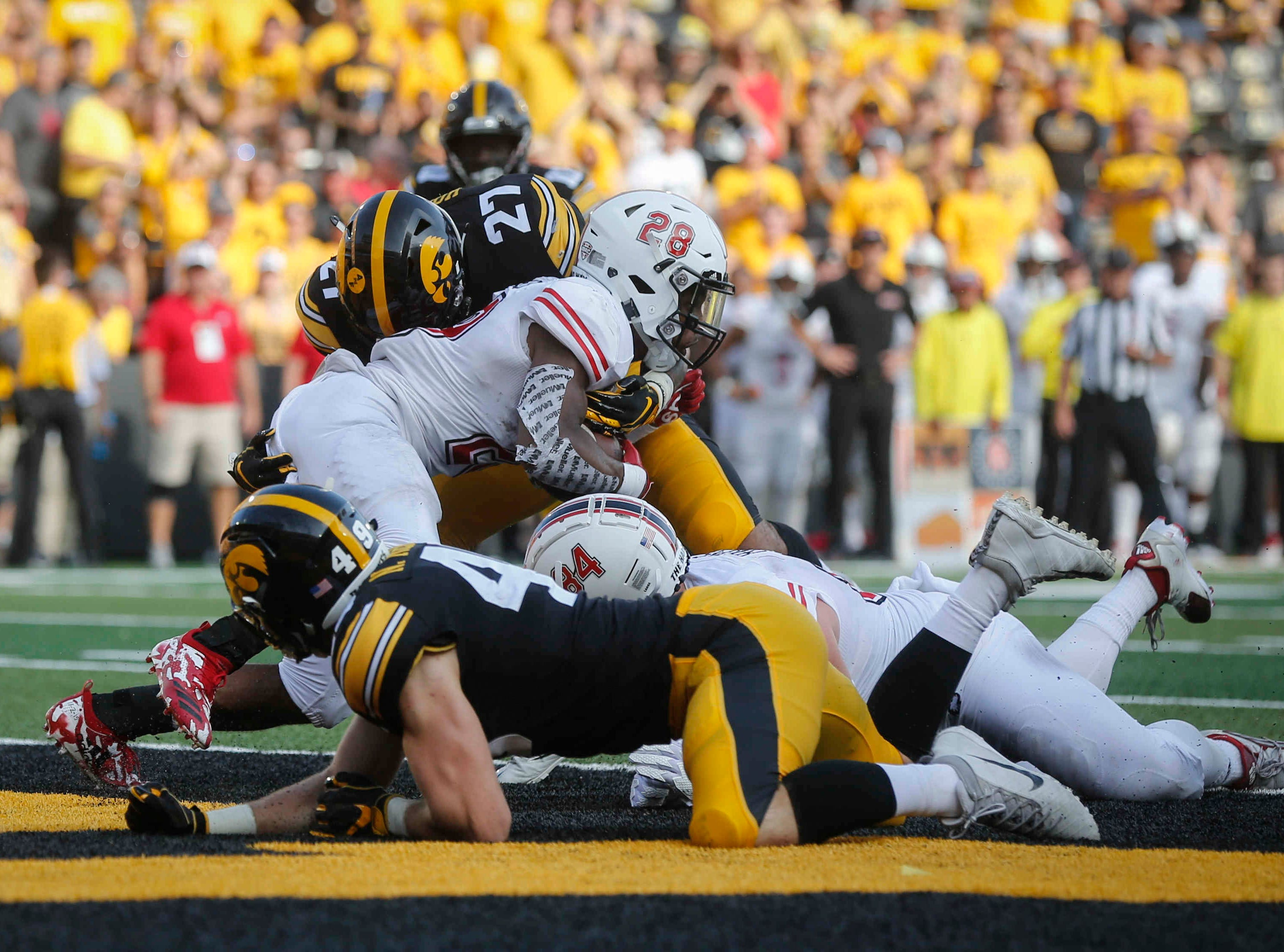 Iowa safety Amani Hooker stops Northern Illinois tailback Jordan Nettles in the end zone for a safety on Saturday, Sept. 1, 2018, at Kinnick Stadium in Iowa City.