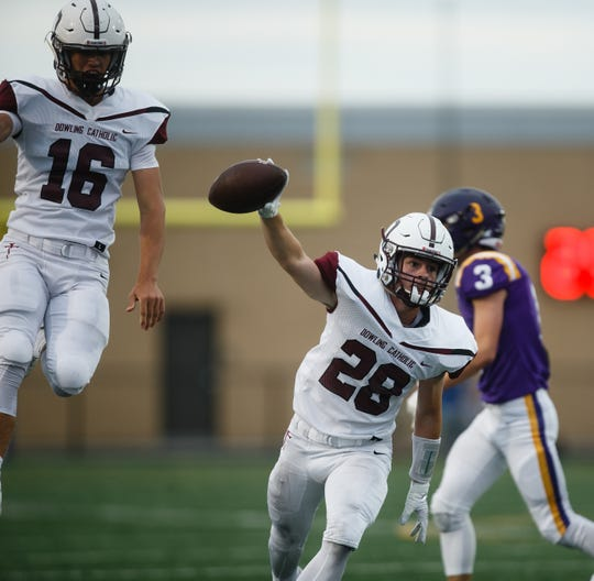 Dowling Catholic's Ryan Adam (28) celebrates recovering a fumble during their football game at Johnston on Friday, Sept. 7, 2018 in Johnston.