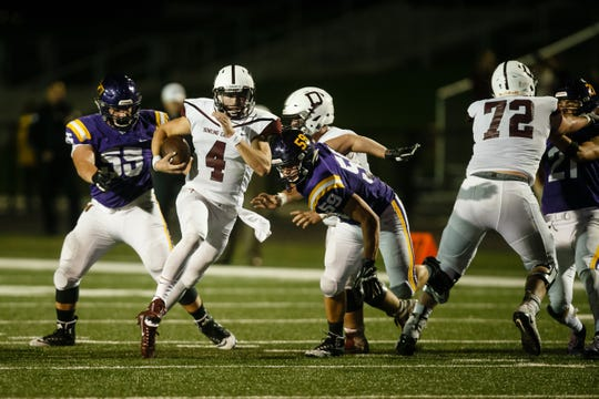 Dowling Catholic's Zach Watters (4) rushes during their football game against Johnston on Friday, Sept. 7, 2018 in Johnston. Dowling Catholic would go on to win 27-0.