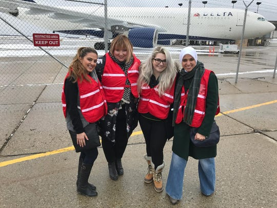 Sumaiya Ahmed Sheikh, left, poses with Phoebe Hopps, Stephanie Kenner and Fatima Salman for a photo at Detroit Metro Aiport, where they organized a January 2017 protest against the Trump administration's travel ban.