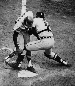 Detroit Tigers catcher Bill Freehan puts the tag on Lou Brock of the St. Louis Cardinals, Oct. 7, 1968 at the plate in the fifth inning of Game 5 of the World Series at Detroit's Tiger Stadium. Brock was attempting to score on Julian Javier' single to left, but Tigers left fielder Willie Horton fired to the plate in time.