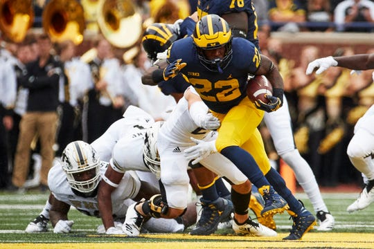 Michigan Wolverines running back Karan Higdon (22) rushes in the first half against the Western Michigan Broncos at Michigan Stadium on Sept. 8, 2018, in Ann Arbor.