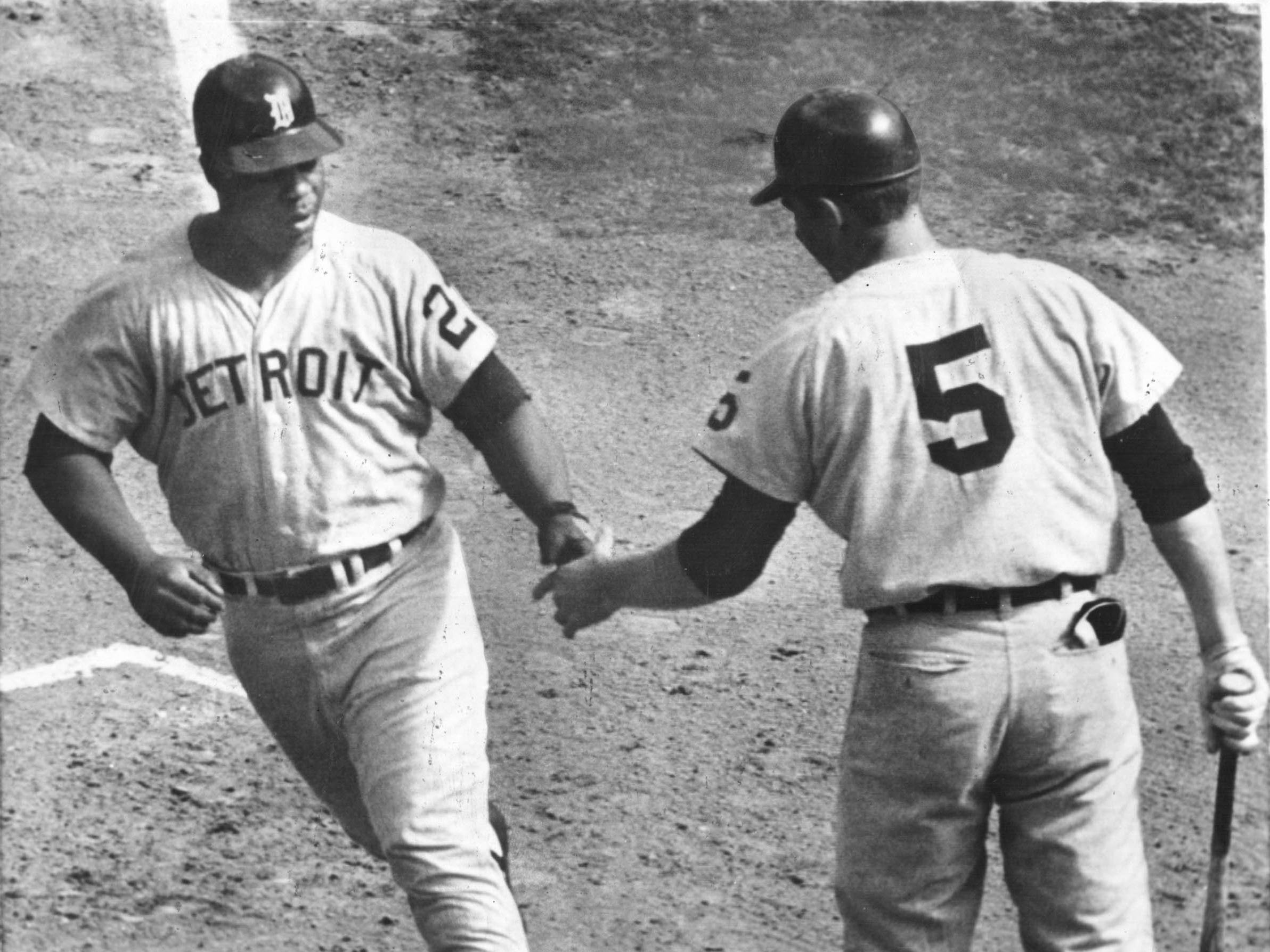 Willie Horton of the Detroit Tigers is greeted at the plate by teammate Jim Northrup after hitting a home run into the lower left center seats at Busch stadium in St. Louis Thursday in second game of World Series Oct. 3,1968.