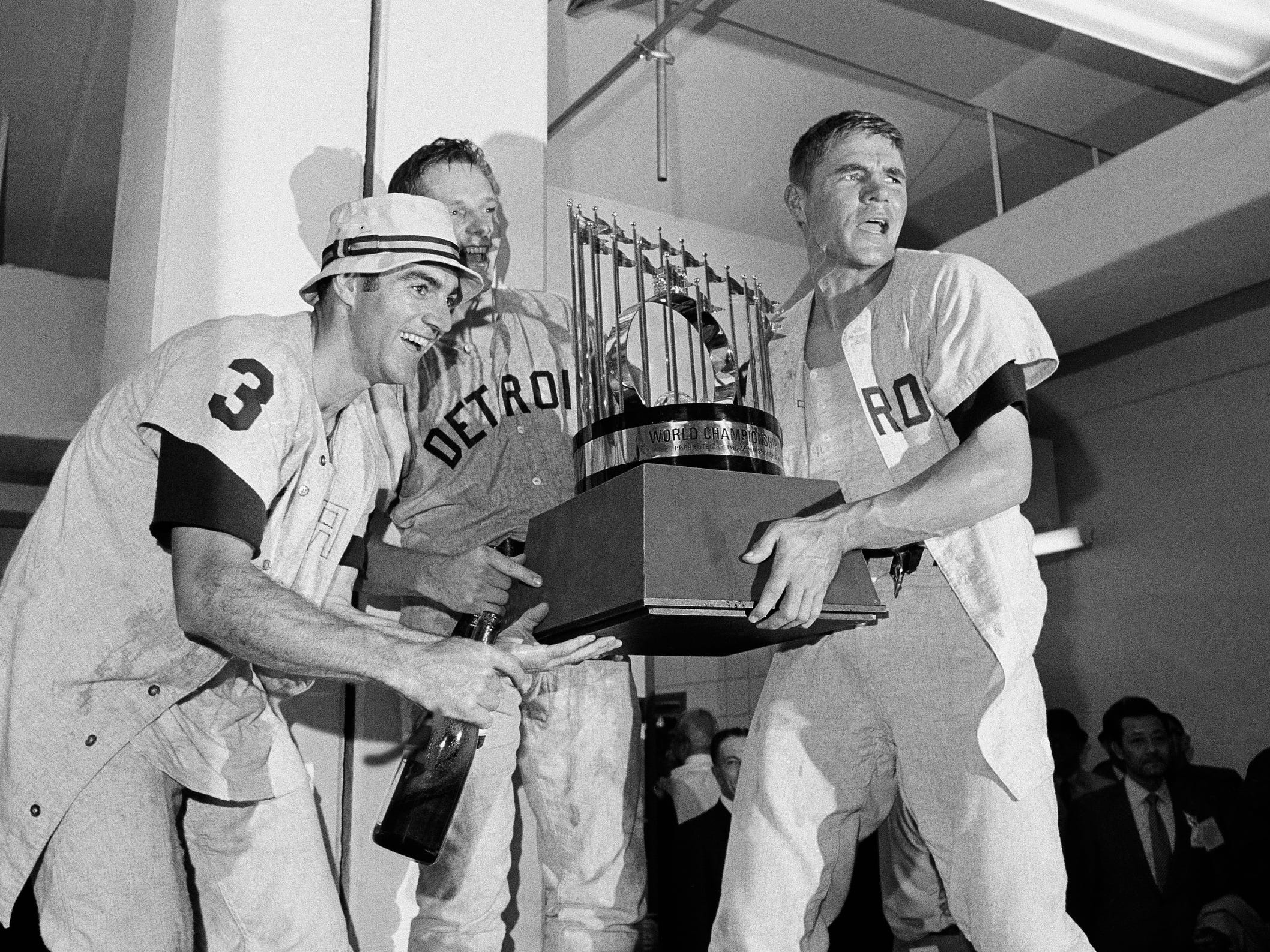 Dick McAuliffe, left, Jim Northrup, center, and Mickey Stanley, with the World Series trophy Oct. 10, 1968 after defeating the St. Louis Cardinals 4 games to 3 at Busch Stadium in St. Louis.