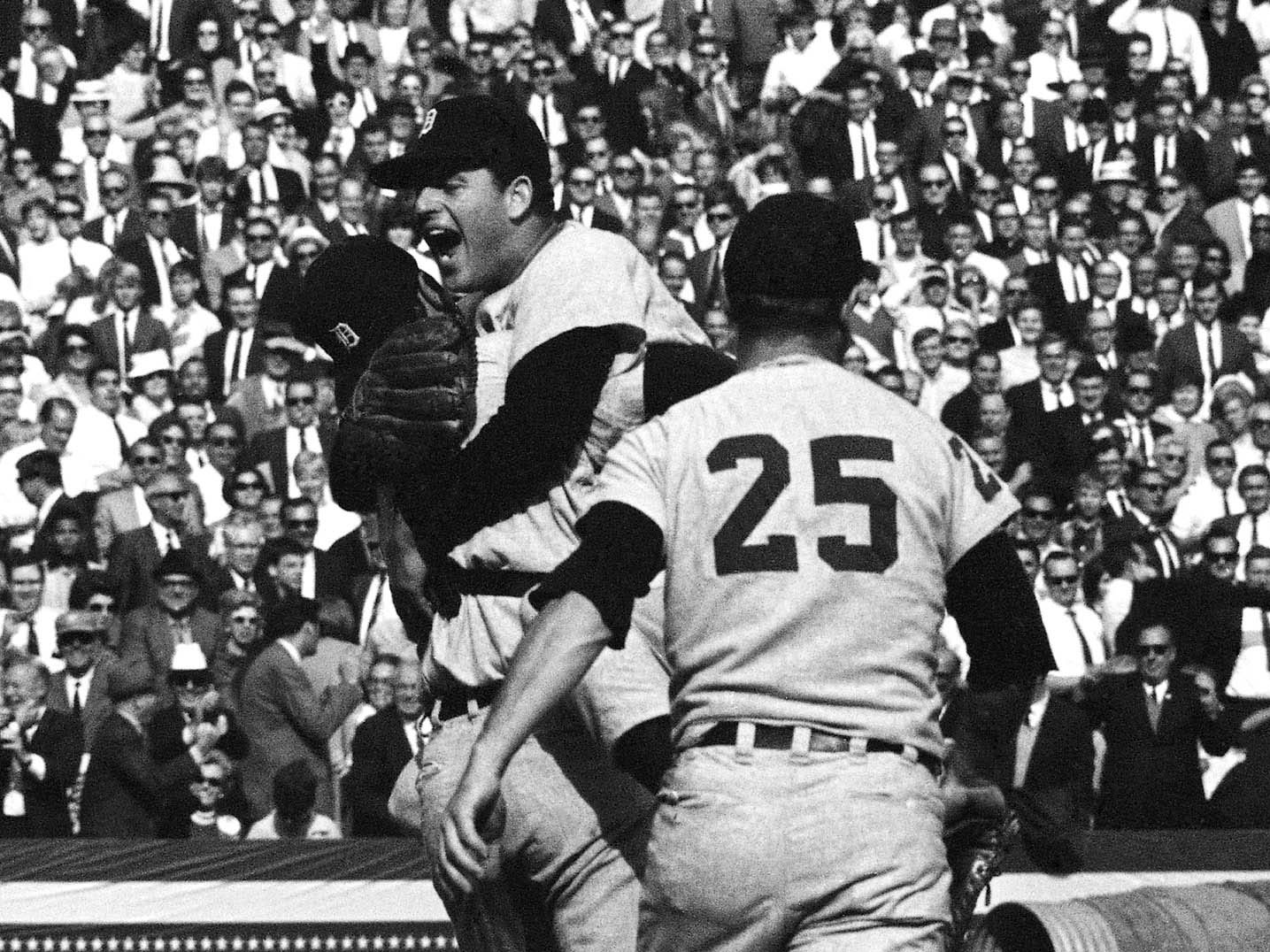 Detroit Tigers catcher Bill Freehan and pitcher Mickey Lolich embrace after defeating the St. Louis Cardinals 4-1 in Game 7 of the World Series on Thursday, Oct. 11, 1968 at Busch Stadium in St. Louis. Joining the celebration is Norm Cash (25). Lolich became the twelfth pitcher to win three games in the World Series.