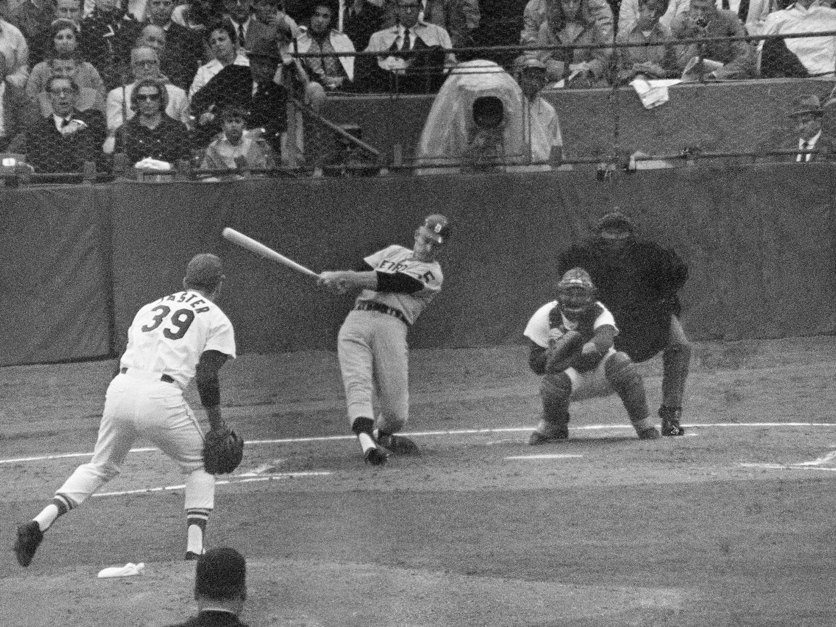Jim Northrup of the Detroit Tigers hits a grand slam homer in the third inning of Game 6 of the World Series off Larry Jaster of the St. Louis Cardinals on Oct. 9, 1968 in St. Louis. Watching is Cards catcher Tim McCarver.