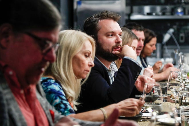 Free Press restaurant critic Mark Kurlyandchik talks to guests during the Detroit Free Press/ Metro Detroit Chevy Dealers Top 10 Takeover at the Chef's Table in Detroit Foundation Hotel in downtown Detroit, Friday, September 7, 2018.