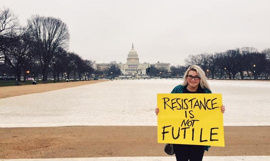 Stephanie Kenner, 30, a Detroiter who moved last month to Washington, D.C., protests during the Women's March on Washington on the day after President Donald Trump's inauguration on Jan. 21, 2017.