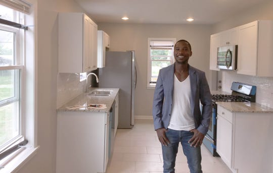 Ishma Best is the director of sales and leasing for Century Partners, a developer involved in the Fitzgerald revitalization project. He is in a renovated home on San Juan Drive in Detroit that includes granite counter-tops, a stainless steel refrigerator and stove, two bathrooms and three bedrooms on Saturday, Sept. 8, 2018.