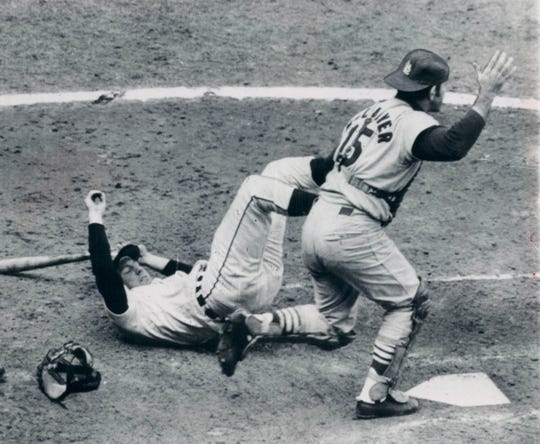 Al Kaline of the Detroit Tigers lands on his back as he attempted to duck from pitch by Nelson Briles of the St. Louis Cardinals, in the fourth inning of the fifth game of World Series at Tiger Stadium in Detroit on  Oct. 7, 1968. The ball hit his bat and rolled toward the mound and Briles picked it up and threw him out. Cards' catcher is Tim McCarver.