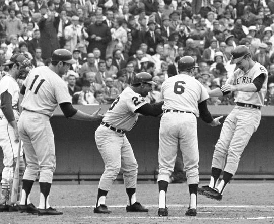 Detroit Tigers' Jim Northrup, right, is greeted at home plate by teammates Al Kaline (6), Willie Horton (23) and Bill Freehan (11) after hitting a grand slam home in the third inning of Game 6 in baseball's World Series at Busch Stadium in St. Louis on Oct. 9, 1968.
