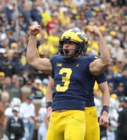 Michigan's Quinn Nordin reacts after an extra point during the first half against Western Michigan Saturday, Sept. 8, 2018, at Michigan Stadium.
