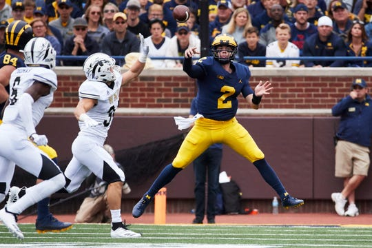 Michigan quarterback Shea Patterson throws a pass in the first half against Western Michigan at Michigan Stadium on Sept. 8, 2018, in Ann Arbor.