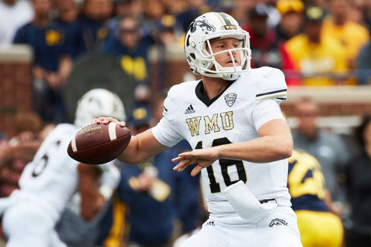 Western Michigan quarterback Jon Wassink passes in the first half against Michigan at Michigan Stadium on Sept. 8, 2018.