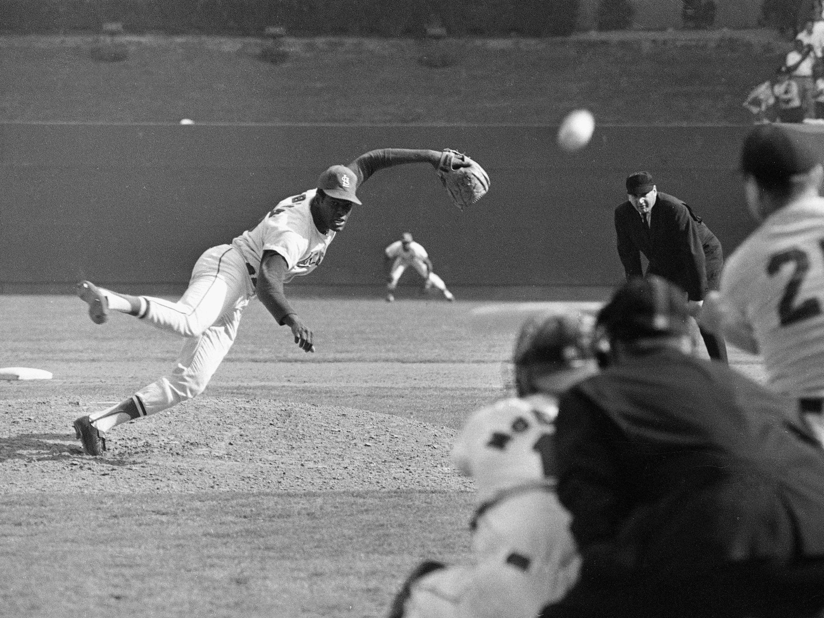 St. Louis Cardinals ace pitcher Bob Gibson fires the ball at Detroit Tigers Norm Cash in the ninth inning of the first game of the 1968 World Series at Busch stadium in St. Louis, Mo. on Oct. 2, 1968.