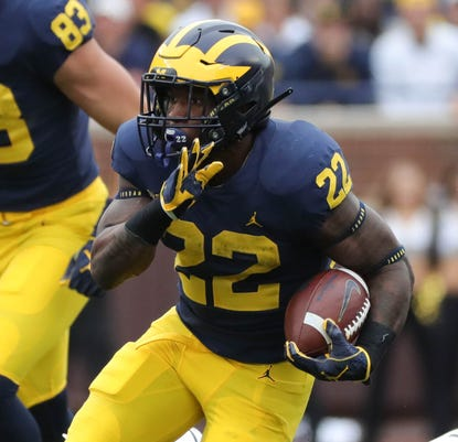 Karan Higdon Runs The Ball Against Western Michigan Photo Kirthmon F Dozier Detroit Free Press