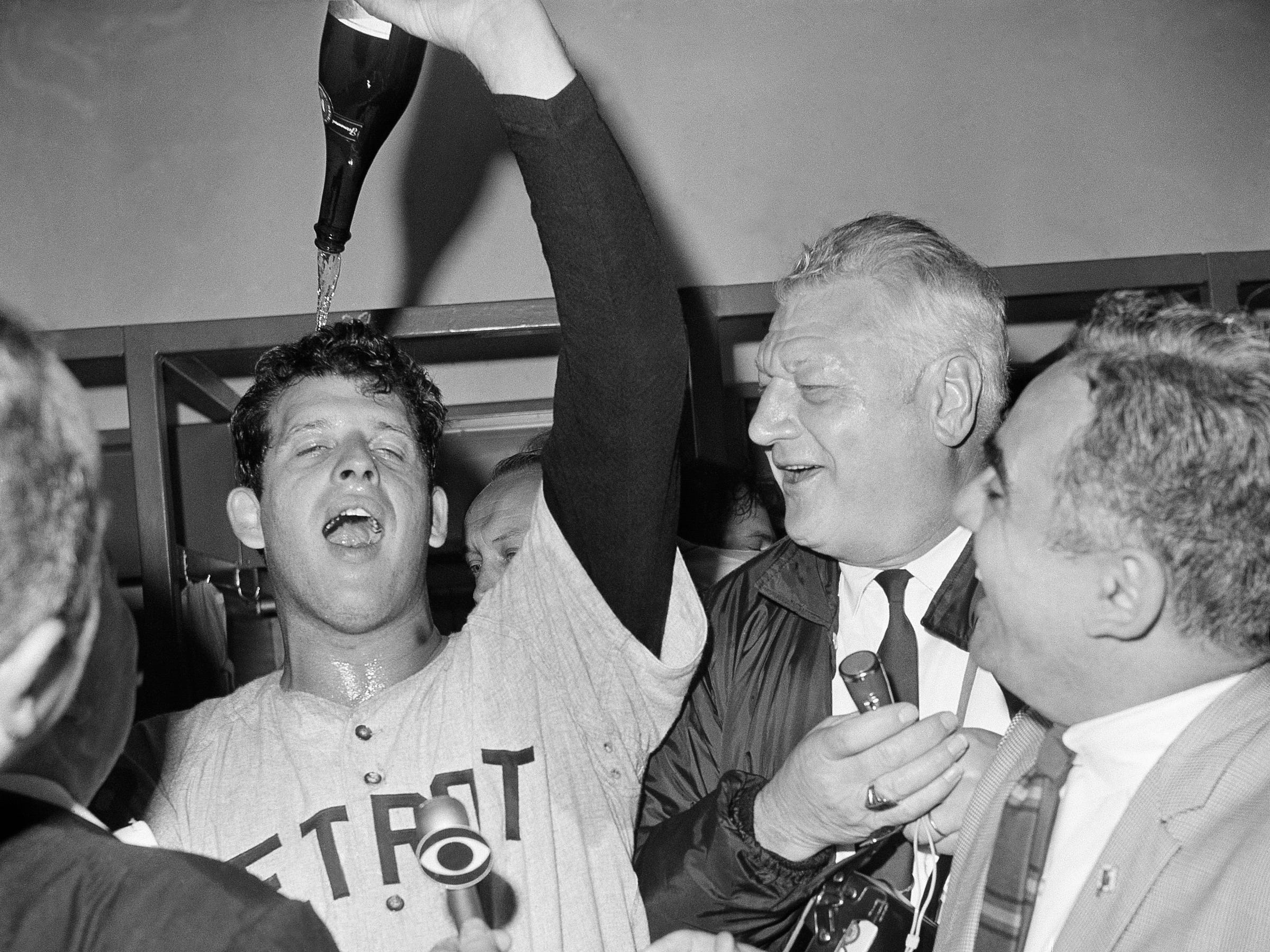 Detroit Tigers Pitcher Mickey Lolich, as he pours bottle of champagne on his head in dressing room after defeating the St. Louis Cardinals 4 to 1 in St. Louis, October 10, 1968.  This was the  final game of  World Series at Busch Stadium.