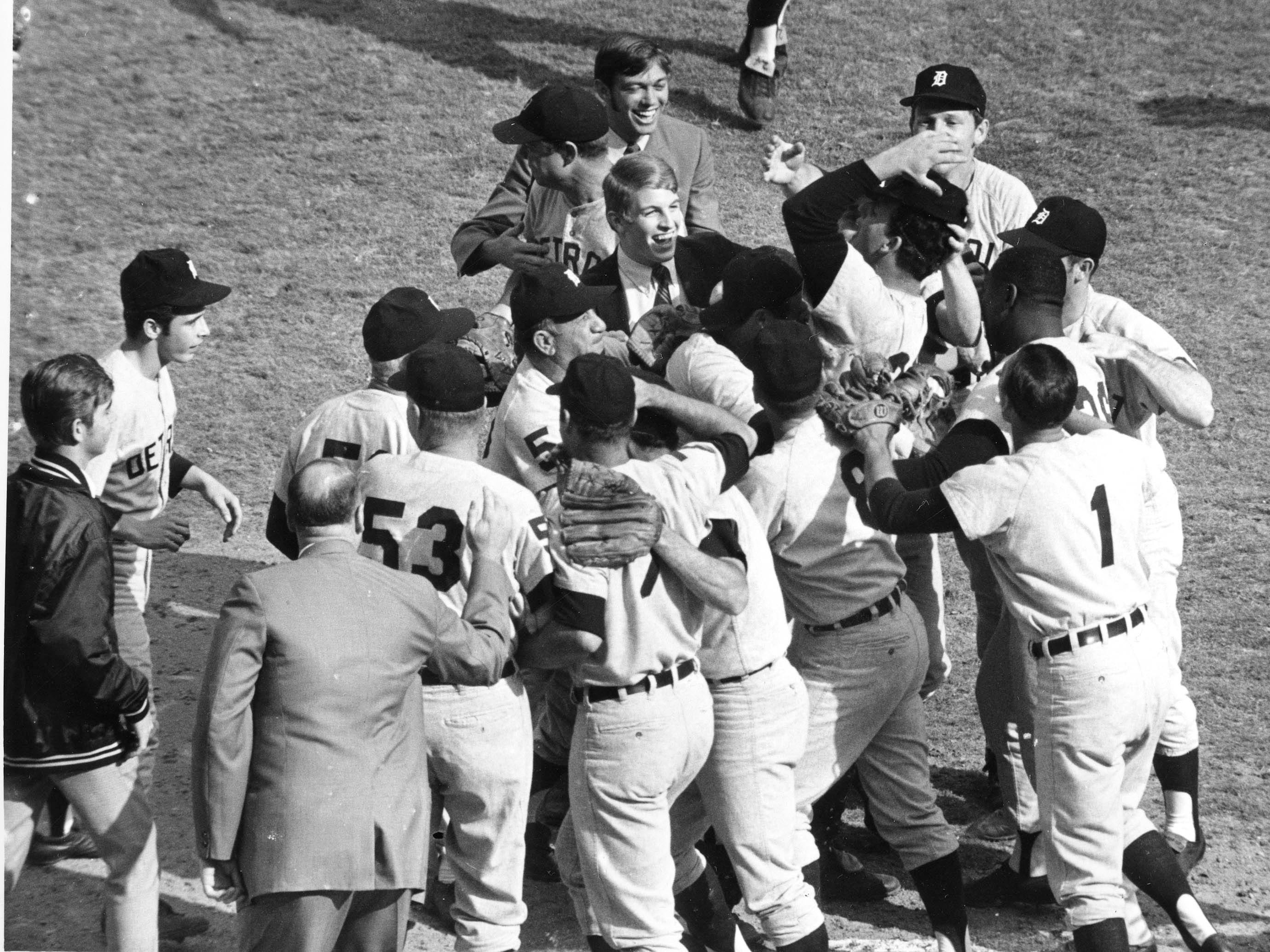 Detroit Tigers pitcher Mickey Lolich is mobbed by teammates after defeating the St. Louis Cardinals 4 to1 in seventh game of World Series action at Busch Stadium in St. Louis, Mo., Thursday, Oct. 10, 1968.