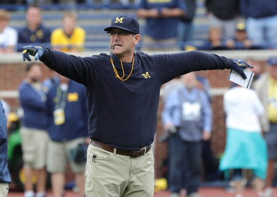 Michigan head coach Jim Harbaugh on the field before action against Western Michigan on Saturday, Sept. 8, 2018, at Michigan Stadium in Ann Arbor.