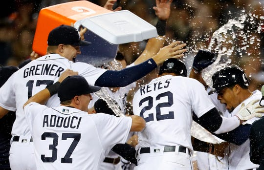 Detroit Tigers' Jeimer Candelario, far right, is congratulated after hitting a two-run, walk off home run in the ninth inning against the St. Louis Cardinals in Detroit, Friday, Sept. 7, 2018. Tigers won 5-3.