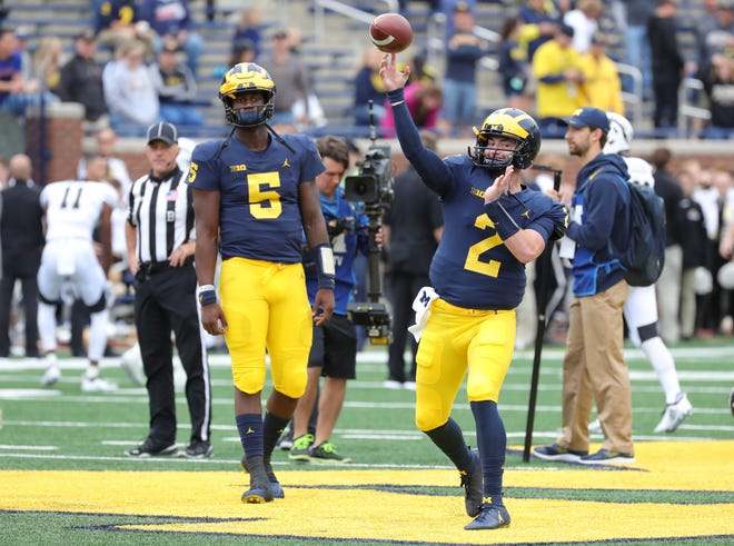 Michigan quarterbacks Joe Milton and Shea Patterson warm up before action against Western Michigan on Saturday, Sept. 8, 2018, at Michigan Stadium in Ann Arbor.