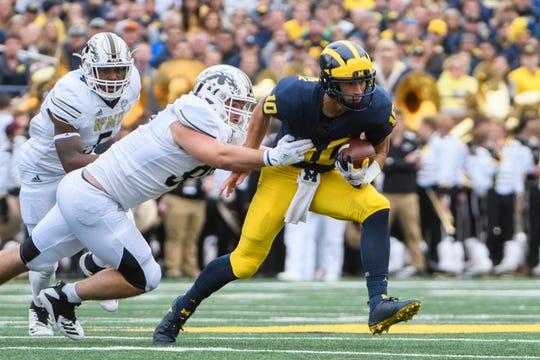 Michigan quarterback Dylan McCaffrey runs the ball in the fourth quarter.