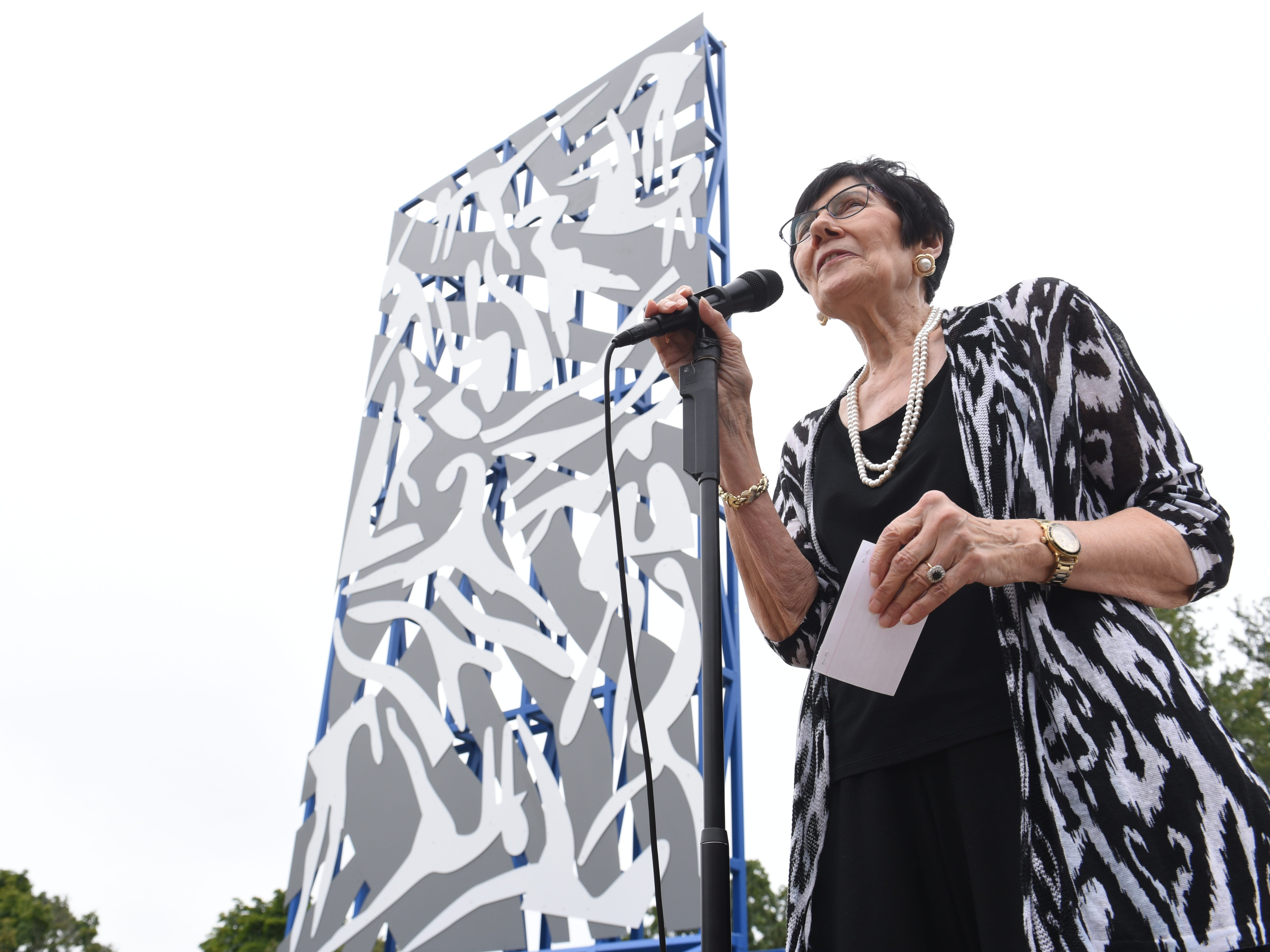 Marsha S.  Bruhn, chairwoman of  The Legacy Project of North Rosedale Park,  speaks during the dedication ceremony.