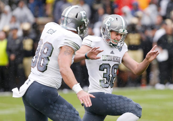 Eastern Michigan kicker Chad Ryland, right, reacts after his field goal lifted the Eagles to a 20-19 victory over Purdue.