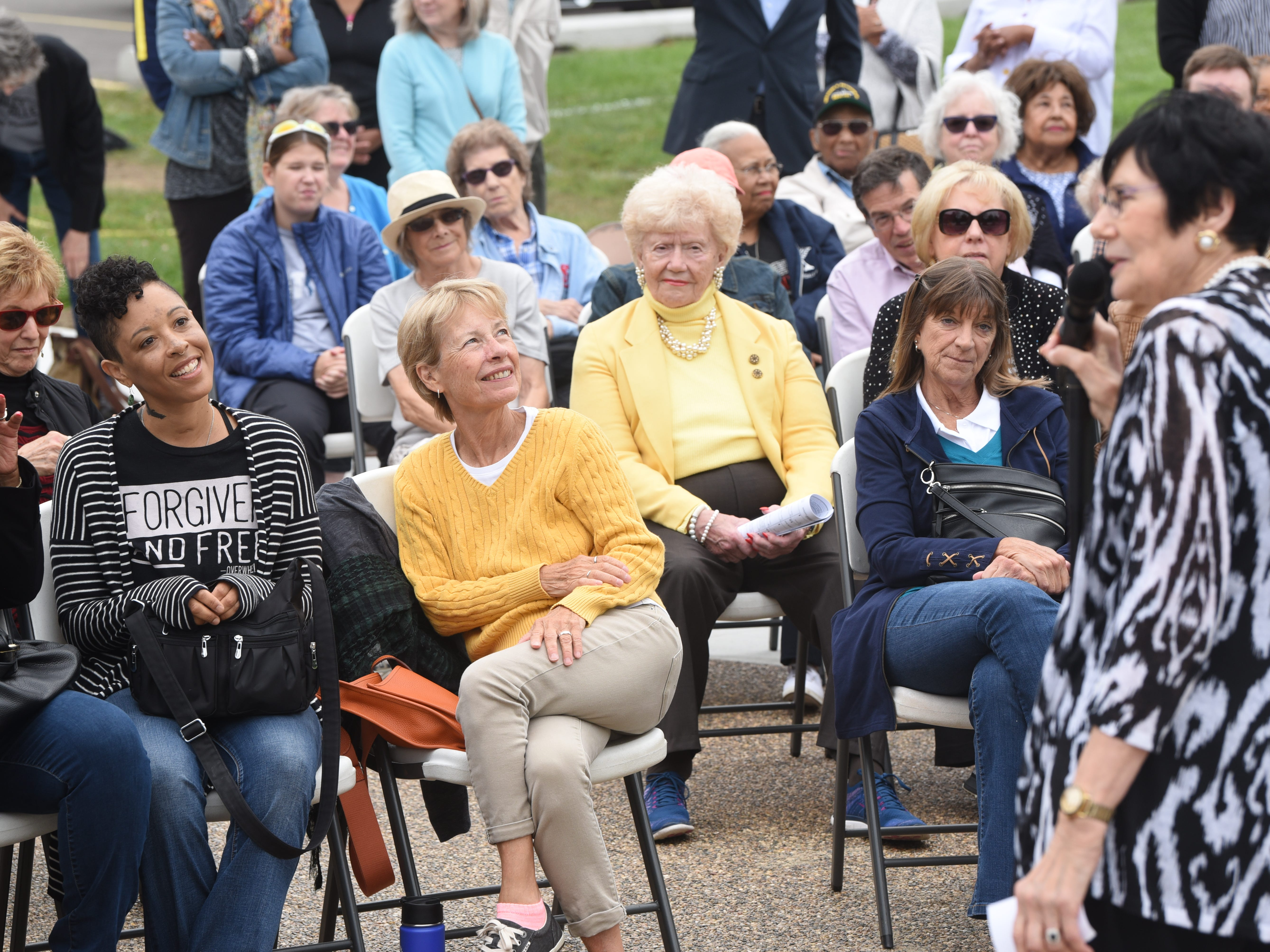 Lyndsay McGee, seated left, daughter of Charles McGee, listens to remarks by Marsha S. Bruhn, chair, The Legacy Project of North Rosedale Park.