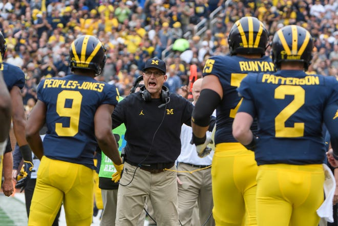 Michigan head coach Jim Harbaugh did not agree with all 13 penalties called against team in Saturday's win over SMU, including a roughing-the-passer infraction whistled against Aidan Hutchinson in fourth quarter.