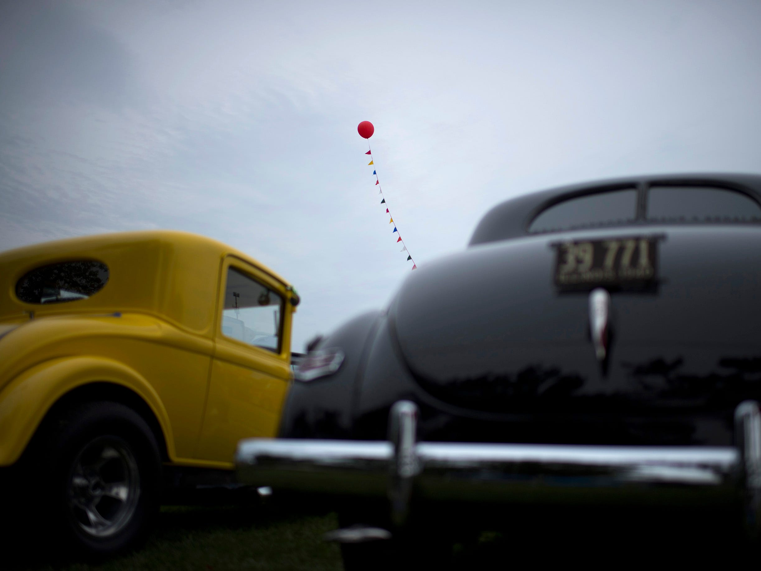 One red balloon floats above the classic cars at the 44th Annual Frog Follies at the Vanderburgh County 4-H Center Friday morning, August 24, 2018. The event continues through Sunday.