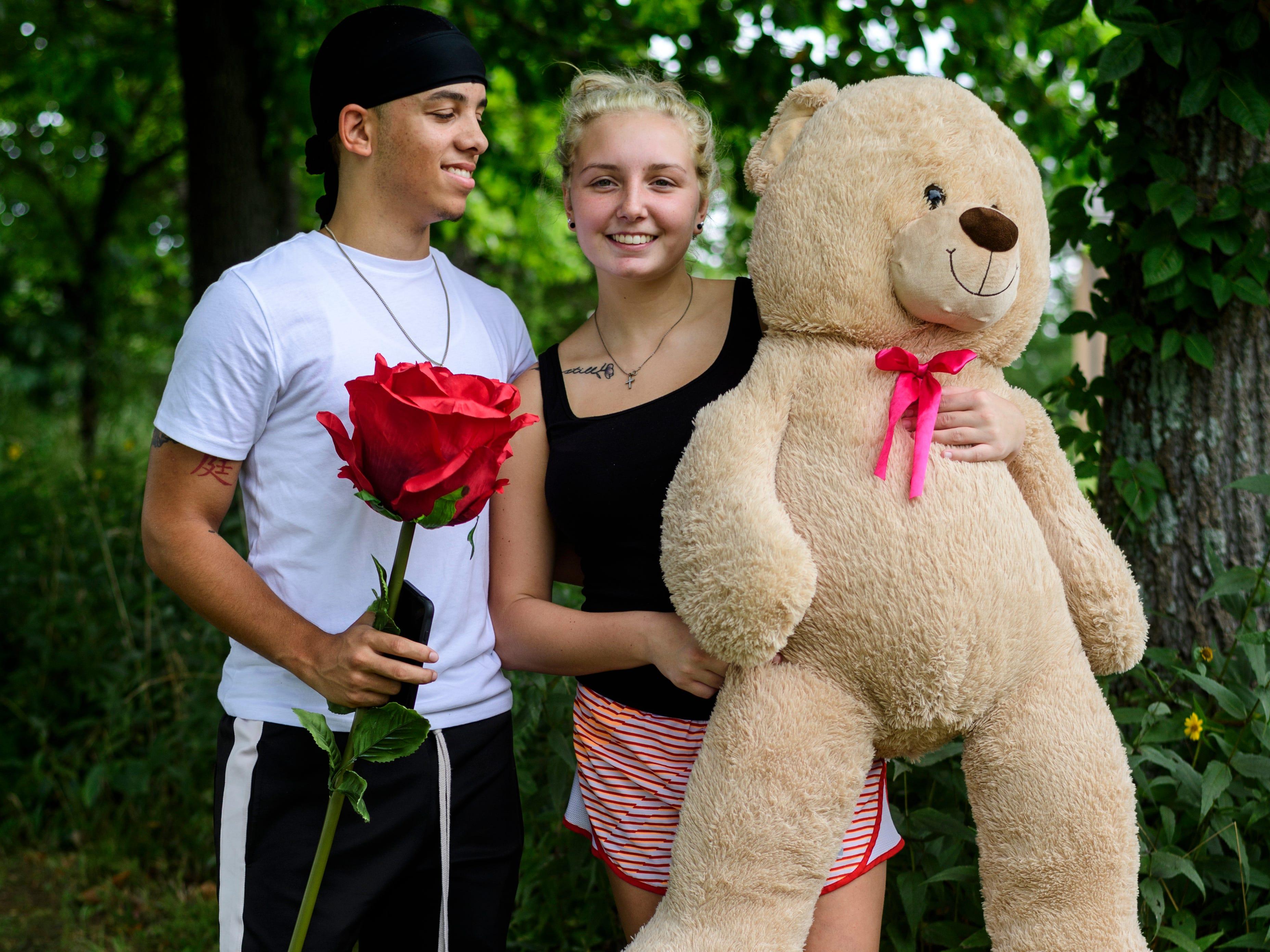 "Haley Barnes of Muncie, Ind., right, is a University of Southern Indiana freshman majoring in dental hygiene. She stands with her boyfriend, Jamaur Davis, left, who gave her a giant stuffed Teddy Bear and large plush rose last Valentine's Day. ""He's going into the Air Force soon, and I have to have a piece of him with me so I brought it,"" Barnes said."