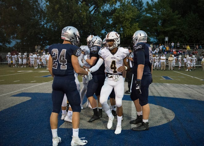 Central's Malcolm DePriest (4) shakes hands with Reitz's Andrew Word after the coin toss before the Bears' 26-21 regular-season win on Sept. 7. The teams will meet again Friday in the Class 4A sectional opener.