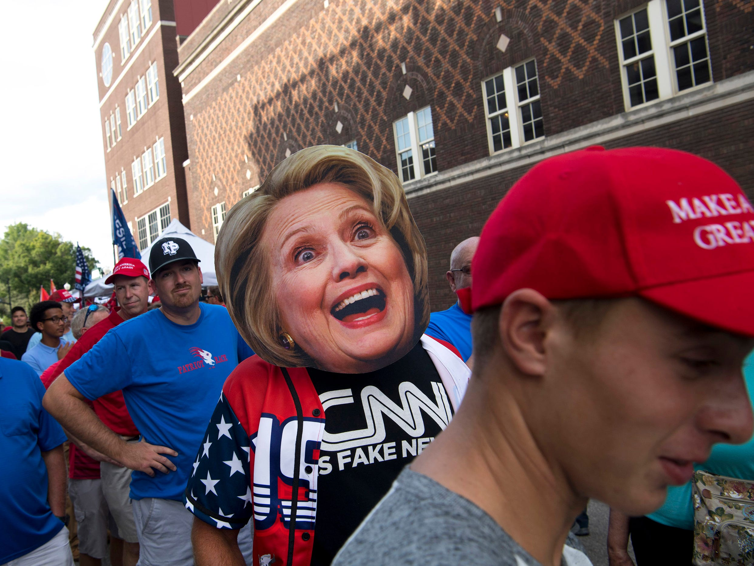 A jubilant replica of Hillary Clinton is worn by a Donald Trump supporter before President Trump's campaign rally at the Ford Center in Evansville, Ind., Thursday, August 30.