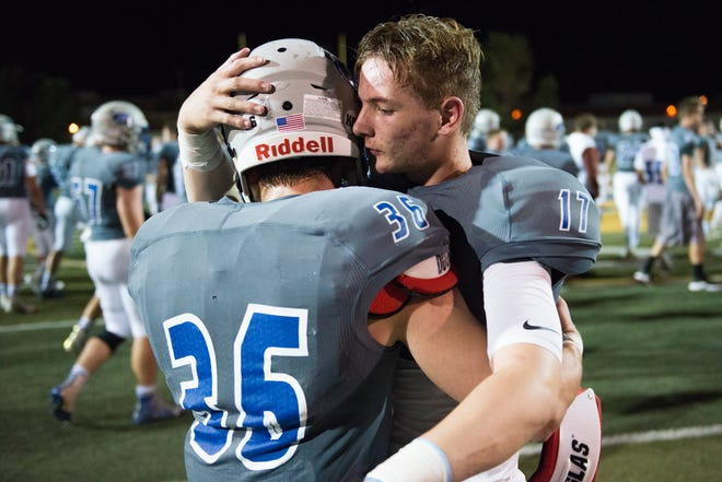 Poudre High School quarterback Trent Graves hugs teammate Tate Satterfield after a 35-10 loss to Ralston Valley at French Field on Friday, September 7, 2018. Satterfield had 85 rushing yards in the game and Graves threw for a touchdown.