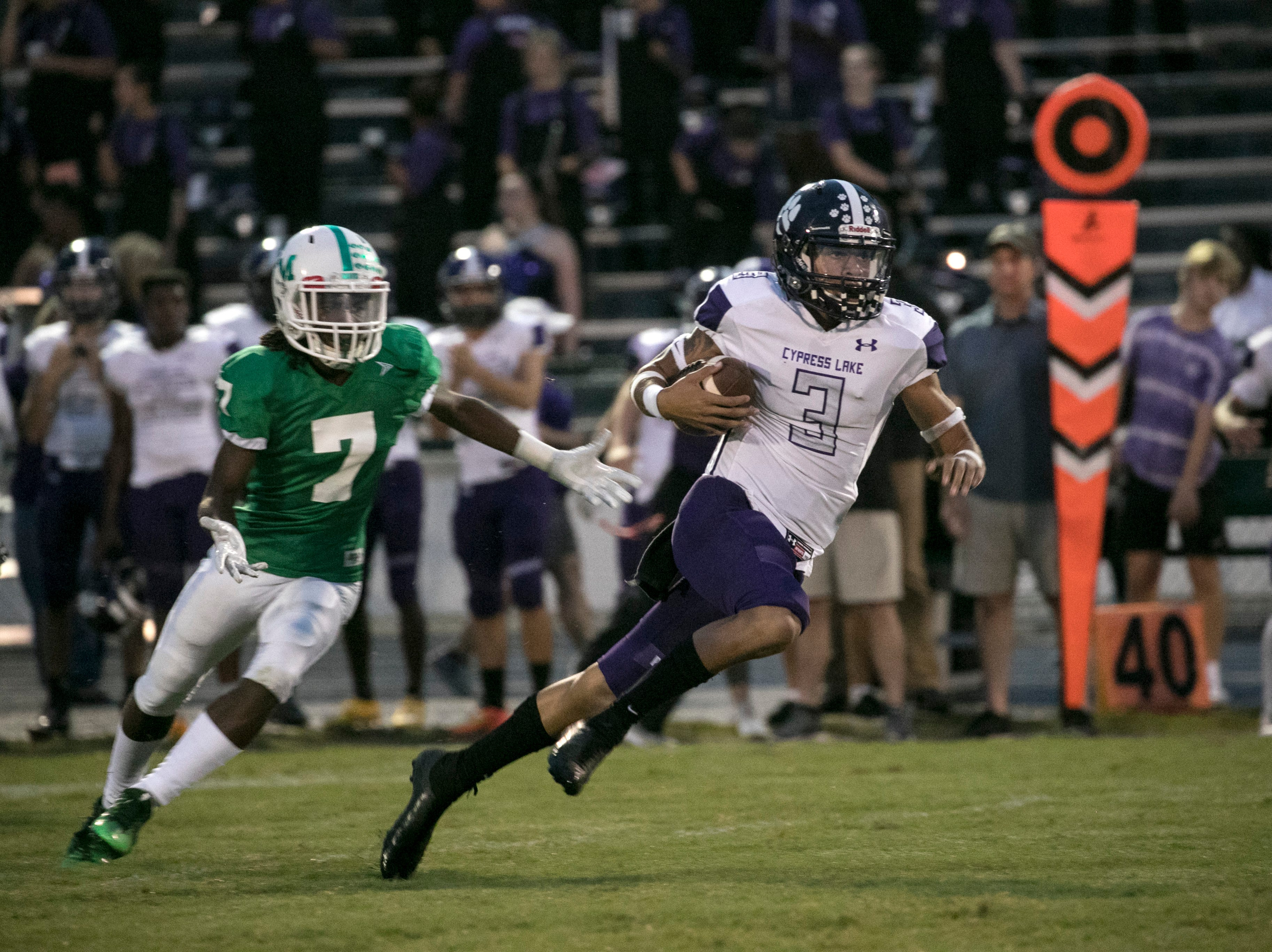Kyrie Savoy of Cypress Lake runs for the end zone before being tackled just short of the goal line on Friday, September 7, 2018, at Fort Myers High School.