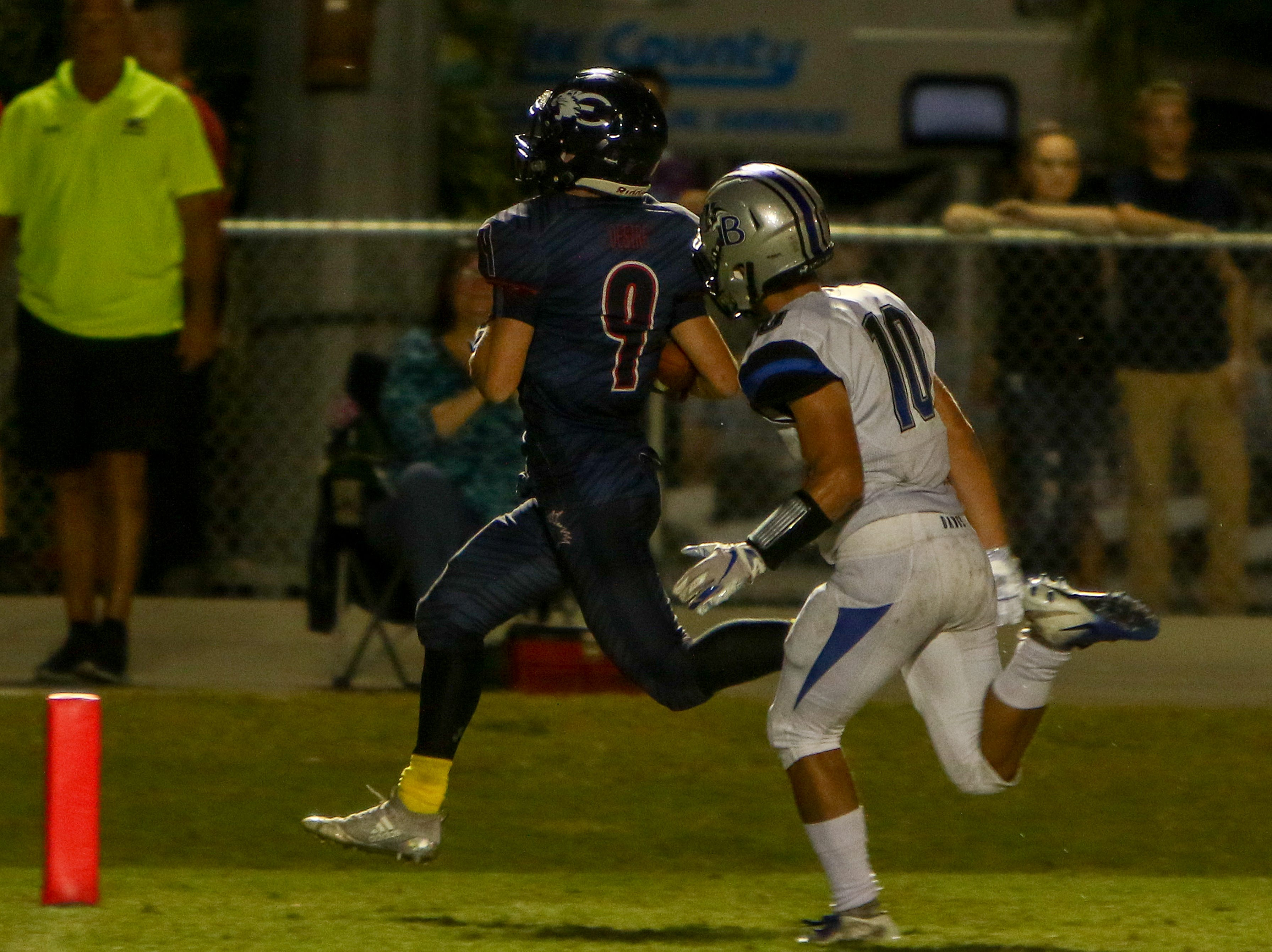 Estero running back Ethan Montgomery busts a long run down the sidelines and beats Bulldog safety Kaeden Price to the end zone.