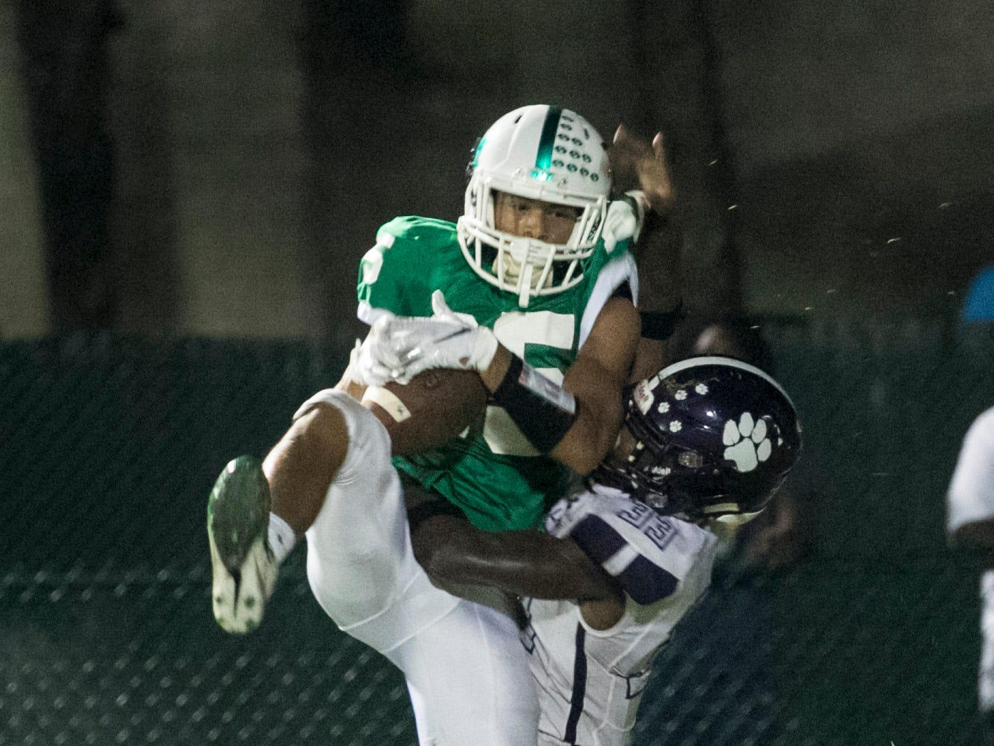 Mason Evans makes a touchdown catch over Cypress Lake's Chris Joseph in the first half on Friday, September 7, 2018, at Fort Myers High School.