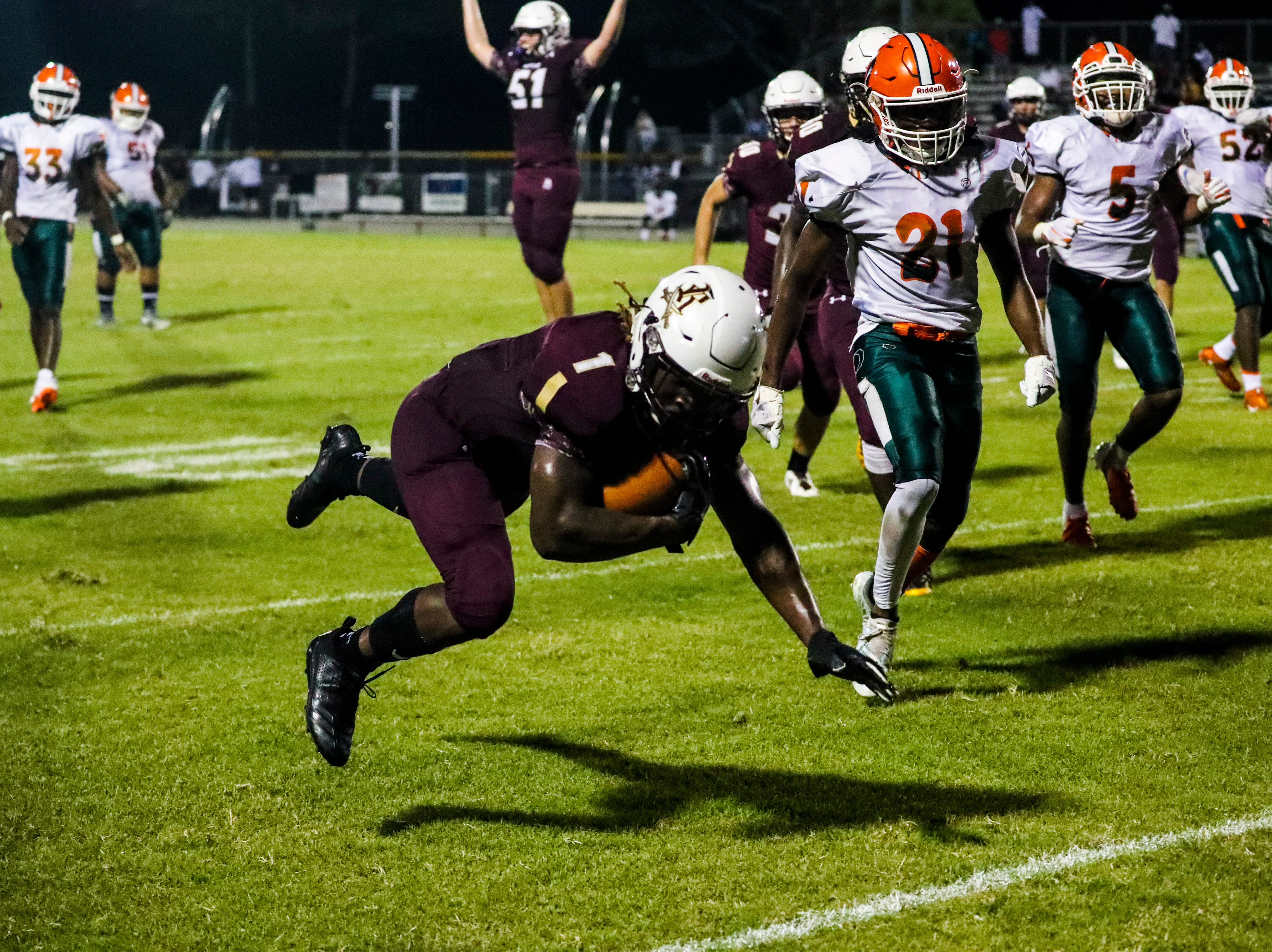 Riverdale's Quantavious Brown goes on to score after this big run into the end zone. Images from the Dunbar at Riverdale high school football game, Friday, September 8th,2018.