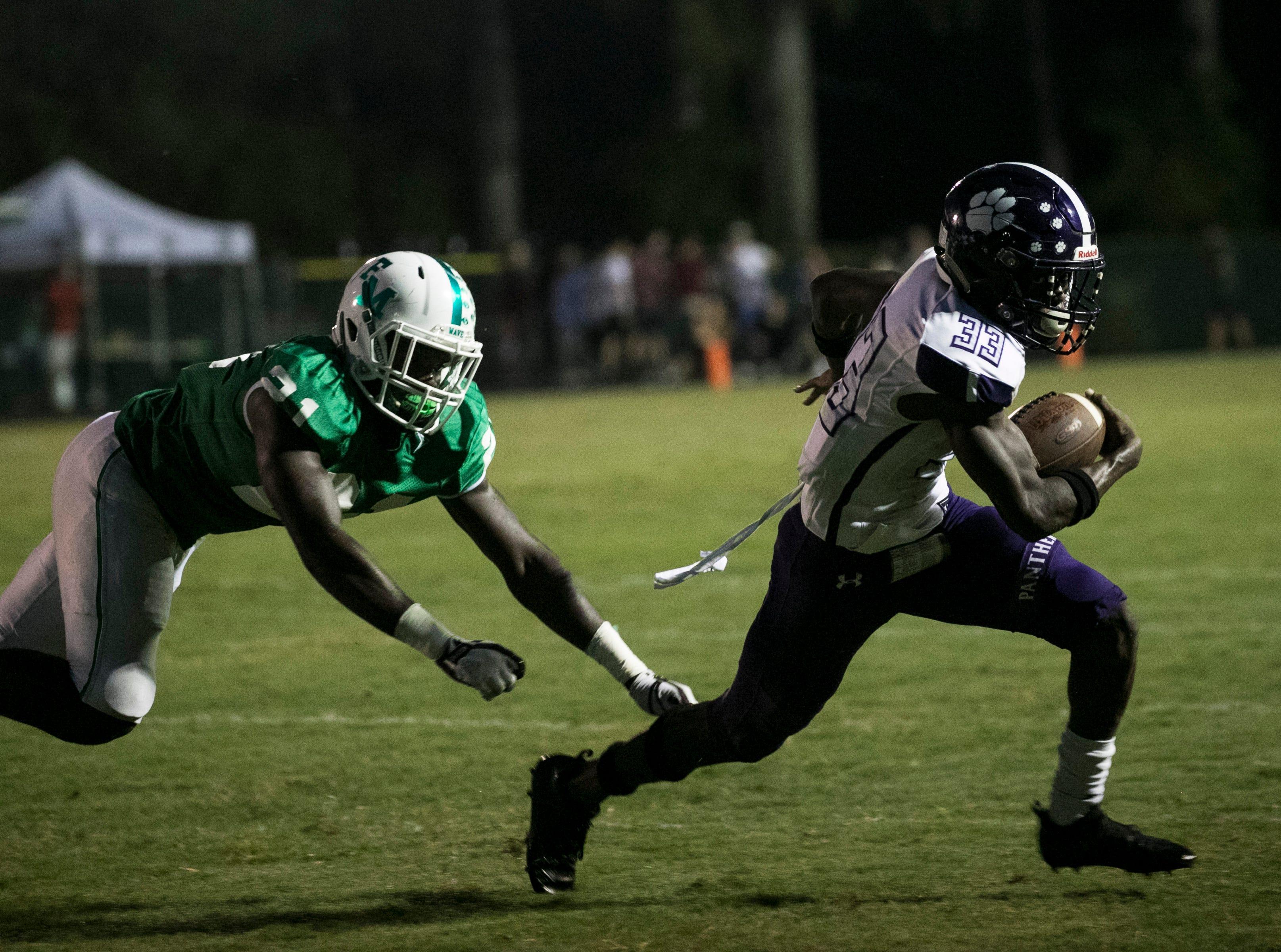 Chris Joseph of Cypress Lake runs the ball against Fort Myers Friday night, September 7, 2018, at Fort Myers High School.
