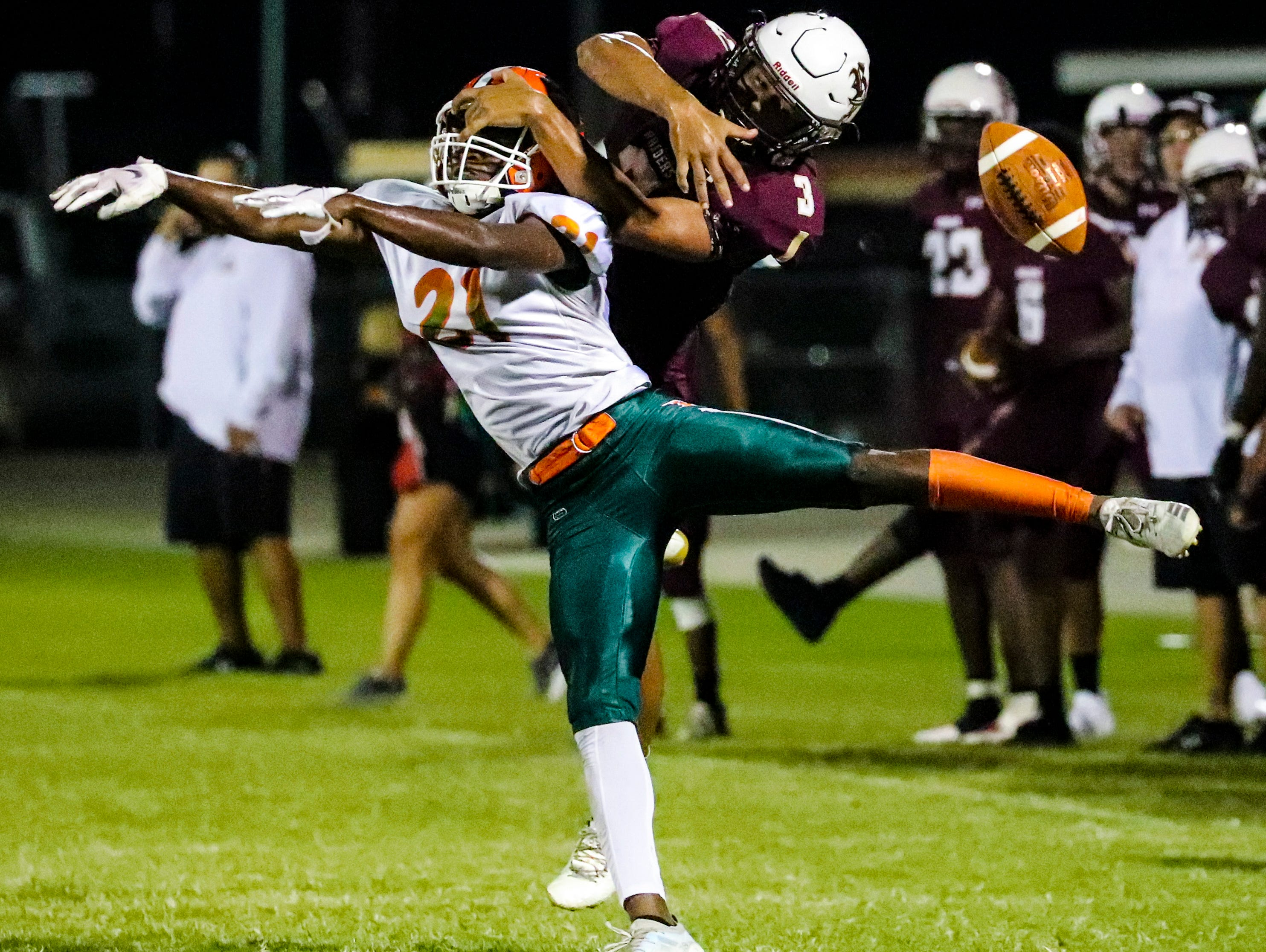 Riverdale's Jaylin Cochran can't make the catch as Dunbar's Tyrel Kennedy breaks up the pass. Images from the Dunbar at Riverdale high school football game, Friday, September 8th,2018.