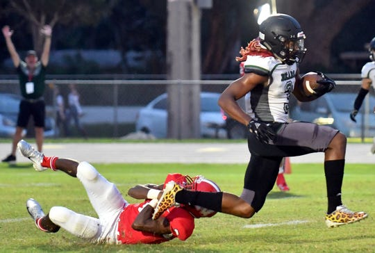 Palmetto Ridge High School Kamonte Grimes (3) breaks away from Tyrone Campbell (2) of North Fort Myers High School, Friday, Sept. 7, 2018. (Chris Tilley/Special to the Naples Daily News)