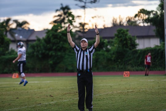 A referee signals touchdown during an Evangelical Christian School vs. Oasis Charter games during the 2018 season.