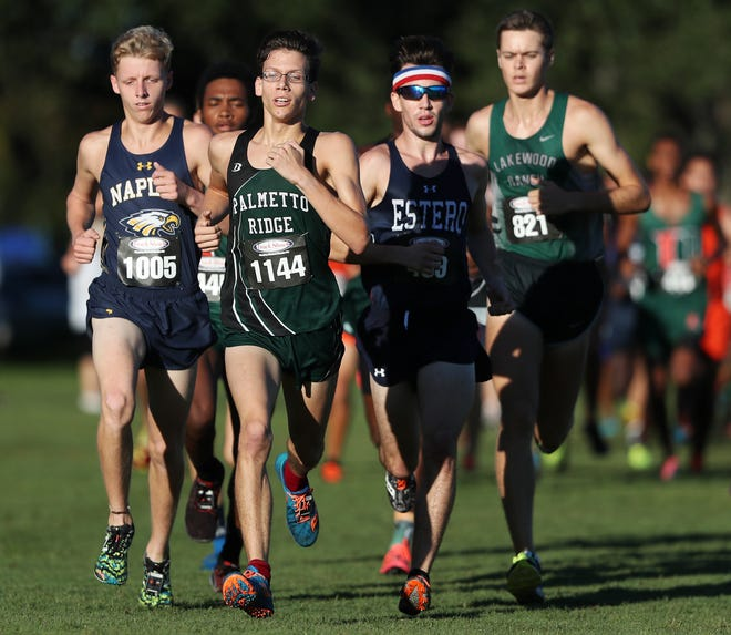 Palmetto Ridge High School's Christian Garcia, center, competes in the Fort Myers Invite on Saturday at Veterans Park in Lehigh Acres. Garcia finished in fourth place. High schools from throughout Southwest Florida competed in the annual event.