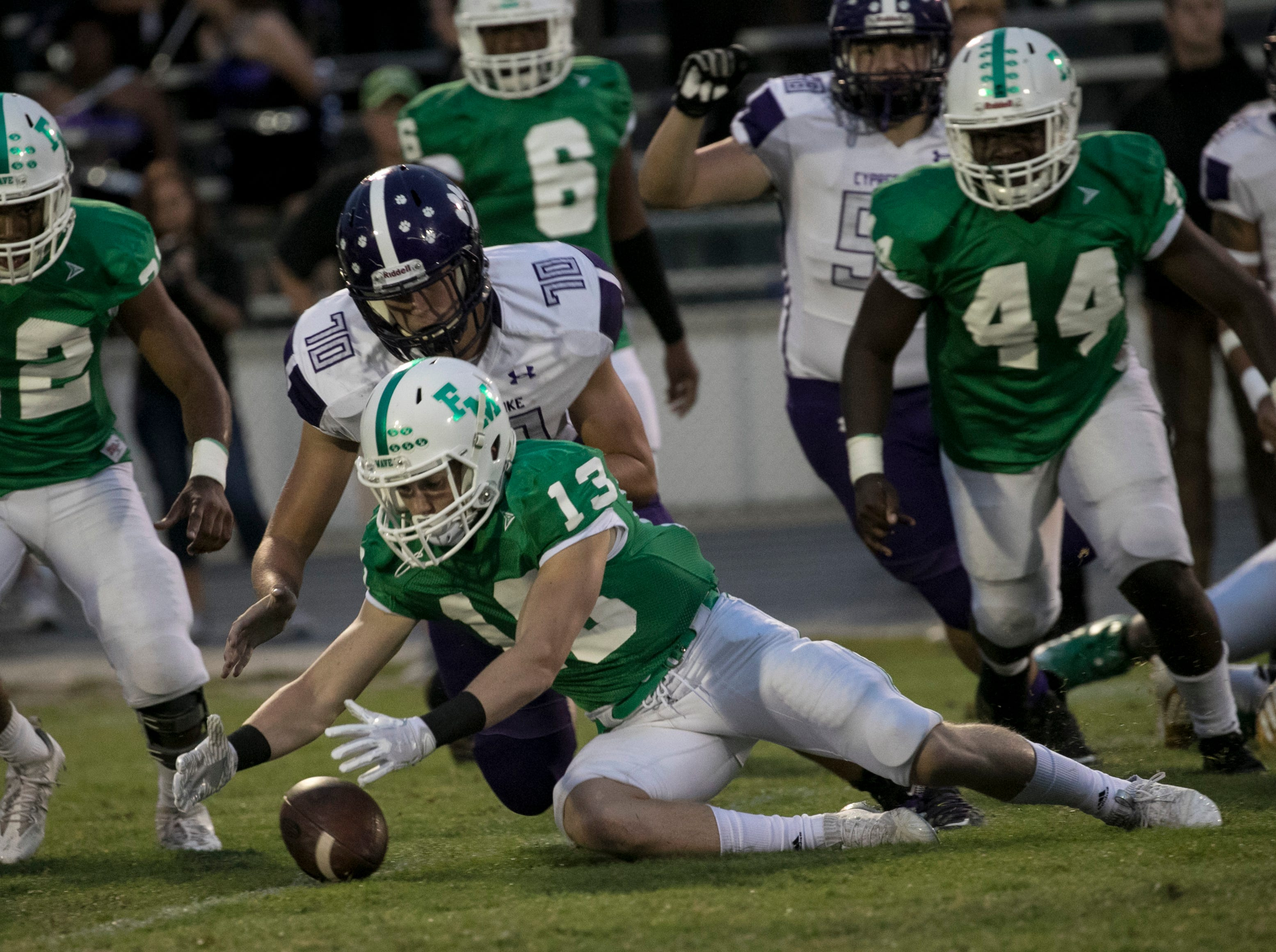Brady Luttrell of Fort Myers recovers a fumble in the first quarter against Cypress Lake on Friday night, September 7, 2018.