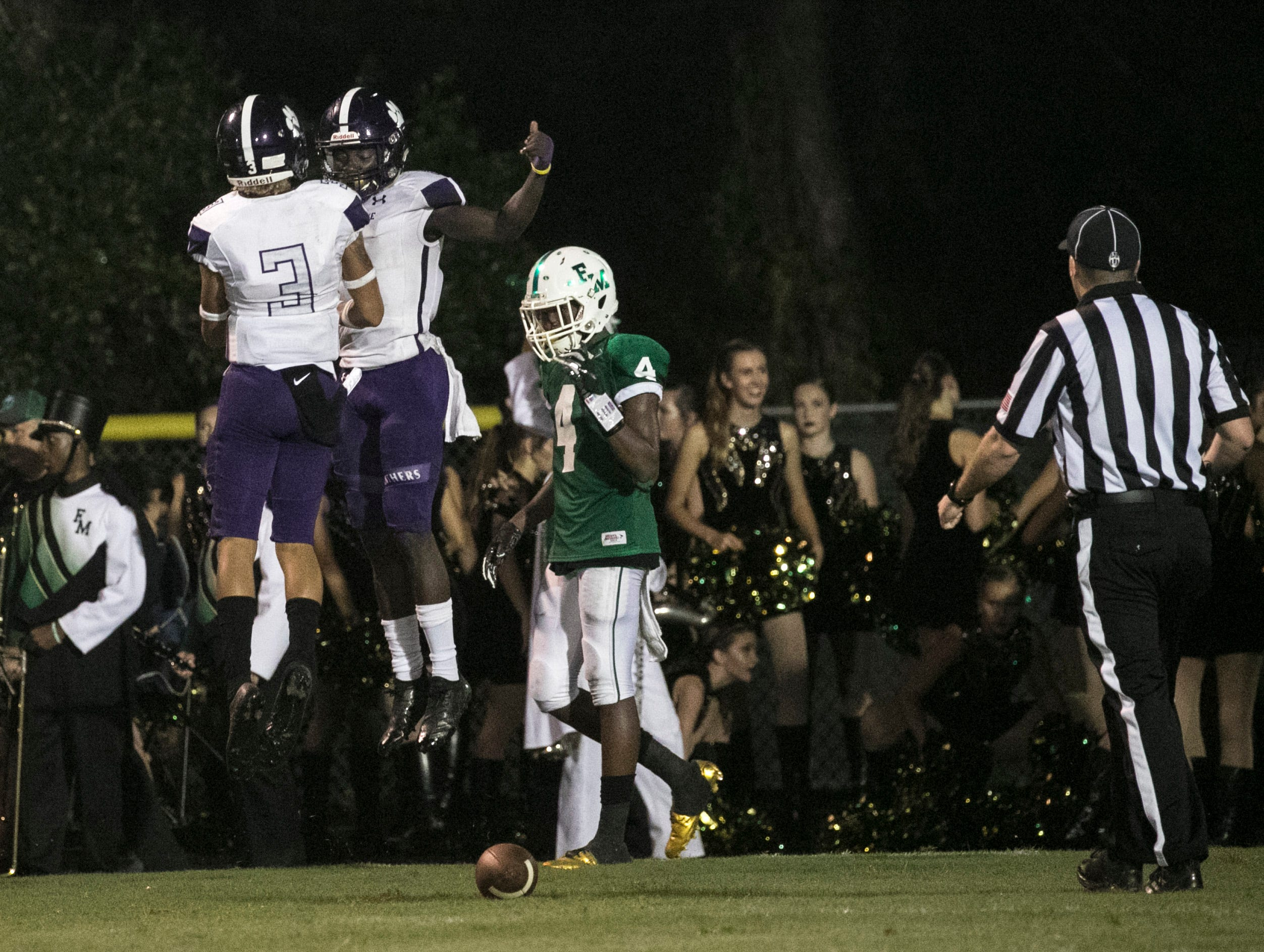 Cypress Lake's Kelsey Demps and Kyrie Savoy celebrate a touchdown by Demps on Friday, September 7, 2018, at Fort Myers High School.
